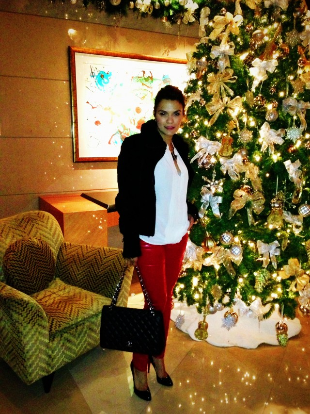 Pants by AG, handbag by Chanel and shoes by Christian Louboutin.