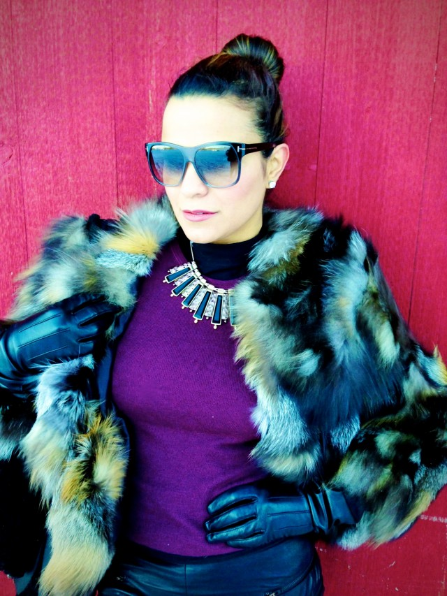 Fur coat by Triology, shirt by Prada, and sunglasses by Tom Ford.
