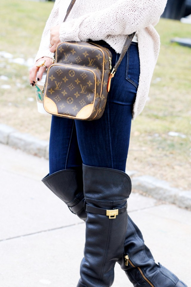 Bag by Louis Vuitton, jeans by J-Brand, and boots by Tory Burch.