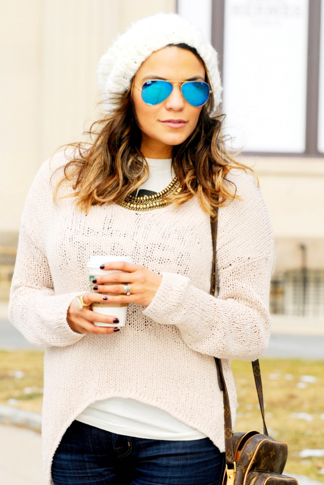 Sunglasses by Ray Ban, sweater by Helmut, and necklace by