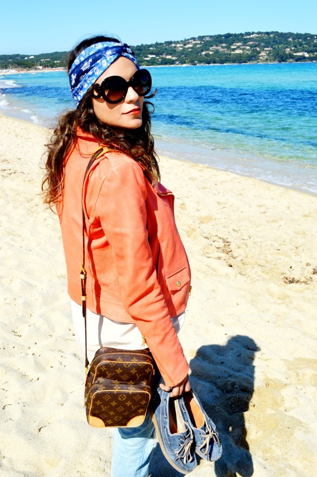 Headband by Ralph Lauren, jacket by Theory, bag by Louis Vuitton, sunnies by Prada and boat shoes by Sperry.