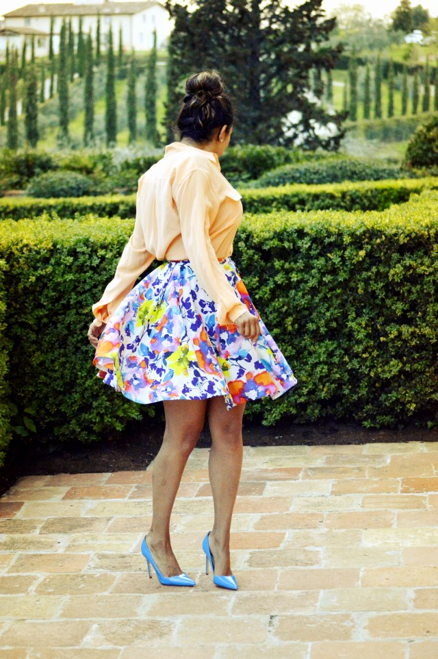 Shirt by Equipment, skirt by Alice and Olivia, and shoes by Manolo Blahnik.