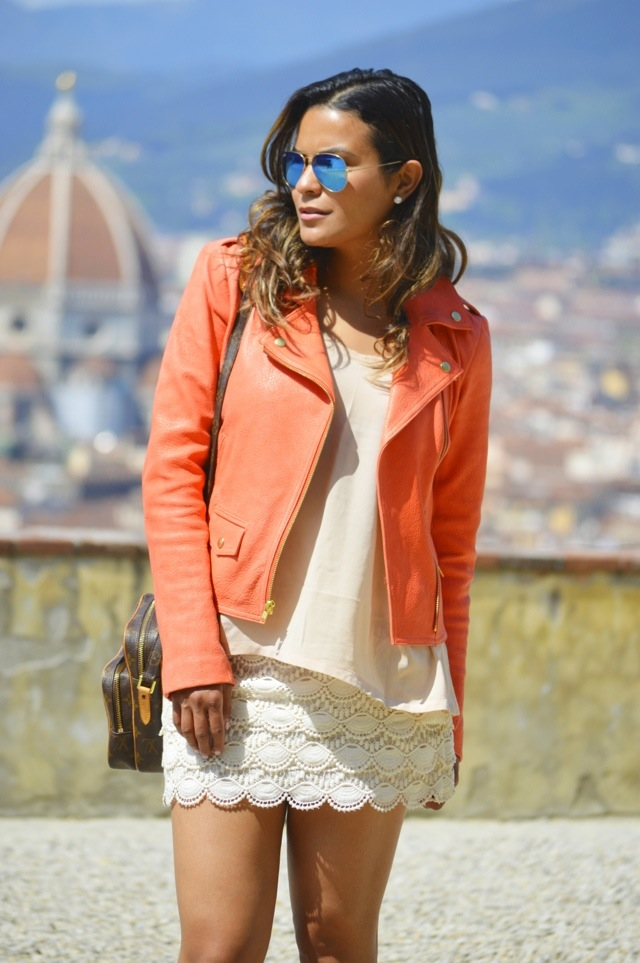 Shirt and skirt by Club Monaco, Jacket by Theory, purse by Louis Vuitton and sunglasses by Ray Ban.